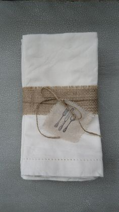 .burlap, jute cord and linen stamped tag