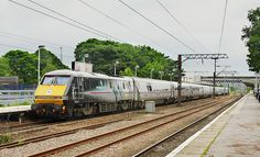 """91110 """"Battle Of Britain Memorial Flight"""" sets off from the Wakefield Westgate stop with Leeds to Kings Cross. Electric Locomotive, Diesel Locomotive, Uk Rail, British Rail, Light Rail, Train Tickets, Battle Of Britain, Wakefield, Trains"""