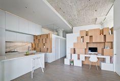 A tiny office tucked into a storage wall