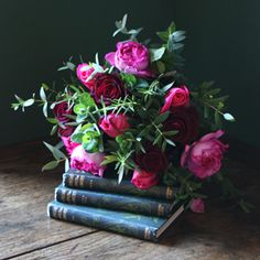 This is simple and exquisite.  I love the arrangement displayed with old worn books. (The Real Flower Company)