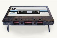 Looking for a piece of furniture? Try the Cassette Coffee Table: a metal-footed, birchwood rig meticulously modeled after an old school mixtape.