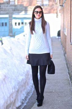 Heathered Blue Cambridge Turtleneck Sweater layered over Fluted Black Skirt with Loafer Tassel Heels