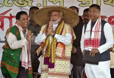 Narendra Modi wearing a traditional hat of Assam
