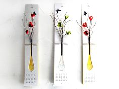 Calendar with an integrated vase so that each month can feature the live flowers that come with that season