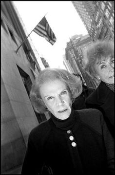 Bruce Gilden - Woman walking on Fifth Avenue. USA. New York City. [1992]