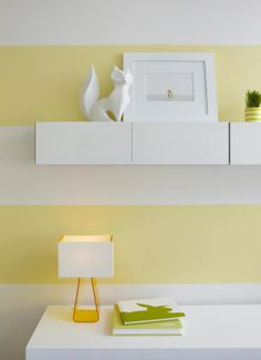 "Love the yellow and white stripes, and the shelf. Benjamin Moore, low-VOC formula - base color for the walls: ""White Opulence"" OC-69 (matte), stripes: ""Little Angel"" 318 (semi-gloss). Shelf is CB2 Hyde White 30"" Wall Mounted Cabinet."