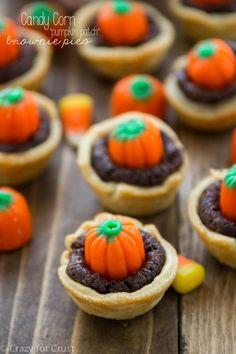 Pumpkin Patch Candy Corn Brownie Pies - an easy brownie pie with just a few ingredients! Top them with candy corn pumpkins for a festive Halloween treat!