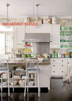 I pretty much love everything about this kitchen... wallpaper, open shelving, white cabinets, antiques, touch of modern silver chairs, light fixtures, open, girlie, fun!!!