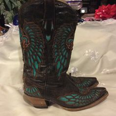 Gorgeous Chocoate Corral Fluer De Lis Cowgirl boot In excellent, rarely worn Corral boots. Beautiful dark chocolate brown color with teal Fluer de Lis and wing design. I didn't wear these much at all, due to having a lot of others I wear more often. I would RATHER TRADE these for another PAIR OF CORRAL boots that I am obsessing over :) these are no longer available online. Corral Boots Shoes Heeled Boots