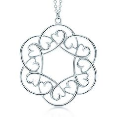 Tiffany & Co Paloma Picasso® Loving Heart swirl pendant in sterling silver. Slightly like, but not at much as the crown of hearts medallion. Wire Wrapped Jewelry, Wire Jewelry, Jewelry Crafts, Beaded Jewelry, Jewelery, Handmade Jewelry, Tiffany Necklace, Tiffany Jewelry, Heart Jewelry