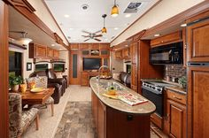Fifth+Wheel+Living+Full-Time | Redwood 38BR Living Area 5th wheel camper trailer.