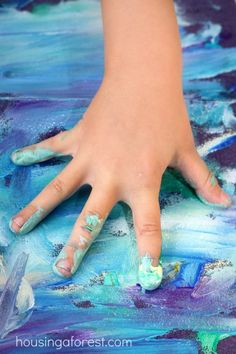 Touch Painting - painting blindly in a box and exploring the sense of touch while creating.