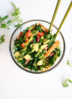 A colorful chopped kale salad bursting with Asian flavors, including ginger, cilantro, Thai basil and soy. This salad is vegan and gluten free.