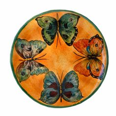 The beautiful butterflies featured on this hand-painted, lushly-glazed collection of classic, artisan-created Mayolica pottery will surely flutter their way into your heart.  Beautiful and vibrant, this collection is a tribute to one of our favorite friends in nature.