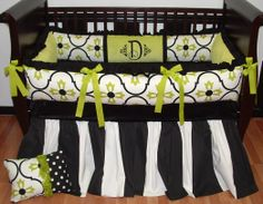Devyn Baby Bedding  Included in this luxurious 3 piece set is the bumper, ultra soft minky crib sheet, and extra long and full ruffled crib skirt.  There is lots of detail in this custom set including soft black bumper ruffles and trim, green apple ultra soft minky, NEW limited edition designer bumper fabric, green apple grosgrain bows, super full and long black and white wide stripe crib skirt.
