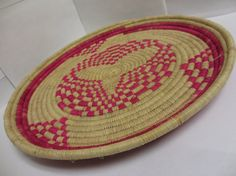 Handmade Woven Natural and Pink Large by NyakaGrandmotherShop Baskets On Wall, Wall Basket, Basket Weaving, Hand Weaving, Valentines Day Gifts For Her, Hot Pads, Serving Platters, Hostess Gifts, Thoughtful Gifts