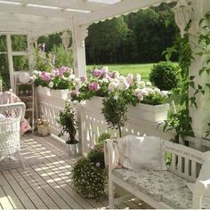 lovely cottage style porch with overflowing window boxes