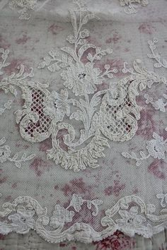 Vintage lace over floral patterns.