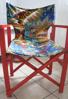 up cycled directors chair by Elsie Florence painted in  red gloss and recovered in vintage superman fabric
