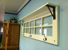 Glass panel door recycling into a coat rack and shelf. Would work well in raw waxed wood and steel too with mirrors in the panels.