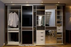Walk in wardrobe / fitted closet. Black glass and mirror doors #wardrobe #storage // Designed by Enhance Sliding Wardrobes www.enhanceslidingwardrobes.com