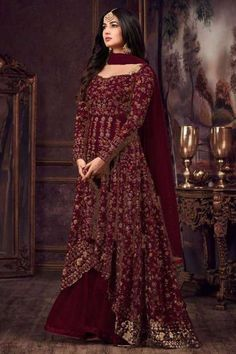 This purple net anarkali salwar kameez is adding the appealing glamorous displaying the sense of cute and graceful. The enticing embroidered and zari work a substantial attribute of this attire. Eid Dresses, Pakistani Dresses, Indian Dresses, Indian Outfits, Bridal Dresses, Girls Dresses, Bridal Outfits, Long Dresses, Ethnic Gown