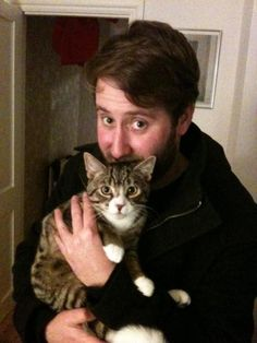 Jim Howick with a cat