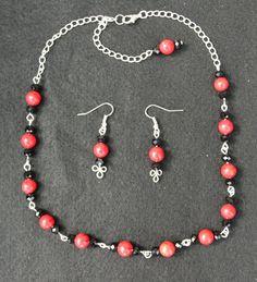 A lovely Handmade Matt Red and Black by sandsjewellerysales