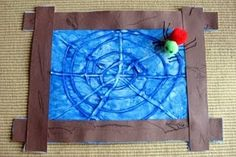 a fun tactile craft to go with the story The Very Busy Spider  Use glue gun to make web, they finger paint over!!