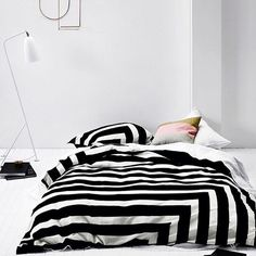 Oh how I love @aurahome - in particular this gorgeous black and white striped design! A classic! #blackandwhite #stripes #aurahome #beddingstyle #monochrome #monochromehome Credit: aurahome.