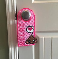 Let everyone know that your bathroom is OCCUPADO so you can do your Number Two in peace with these adorable, handmade Perler bead door hangers. Perfect for small children - or adults with the scatological sense of humor of small children! The door hangers are 24 cm (9 1/2) long and