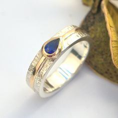Sapphire pear silver and gold ring wicker textured band gold stripe shoulder accents Gold And Silver Rings, Silver Jewelry, Bespoke Jewellery, Gold Stripes, Bronze Sculpture, Gold Bands, Metal Working, Pear, Wicker