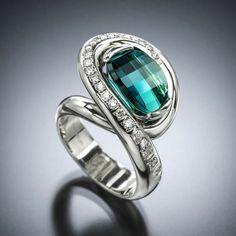 Aria Indicolite Tourmaline Ring is memorable and harmonious. This unique ring design features a stunning blue-green (indicolite) tourmaline with diamonds in 14 karat white gold.