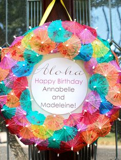 great summer party idea.  Use a styrofoam wreath and stick cocktail umbrellas in it!! EASY!