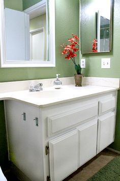 Repainting Bathroom Cabinets- Quick and EASY - This was one of the fastest mini makeover's ever- repainting the old bathroom cabinets white for a fresh updated…