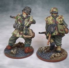 These guys were sitting on my painting table for the better part of two months and finally they're done. Somehow a combina. Military Figures, Military Diorama, Bolt Action Game, Bolt Action Miniatures, Camouflage Patterns, German Uniforms, Action Painting, German Army, Toy Soldiers