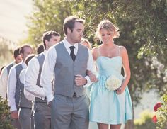little blue dresses + boys in vests without coats. Very casual and fitting for a summer wedding.