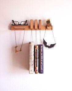 Custom made wooden book rack / bookshelf in Walnut. by OldAndCold