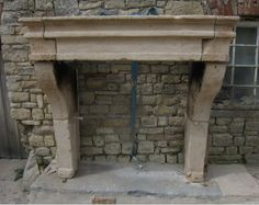 A large early 17th Century LXIII fireplace. Superb rustic earthy look with wonderful texture, wear and colour to the stone. A rare piece. For Sale on SalvoWEB from Wharton Antiques in Somerset [Salvo code