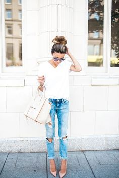 Simple white tee, destroyed denim, and heels. So cute for spring!