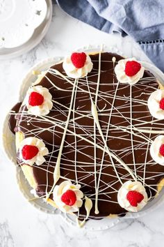This white chocolate cheesecake is a stunning dessert. Smooth and creamy with an Oreo cookie crust and topped with chocolate ganache - it's the ULTIMATE white chocolate cheesecake! #whitechocolate #cheesecake #oreo #fromscratch #dessert #cheesecakerecipe #ganache #easy #dessertrecipes