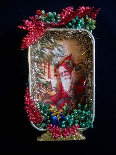 Christmas Shadowbox Santa Deer Original Altered Altoid Tin Collage with Stand. $25.00, via Etsy.