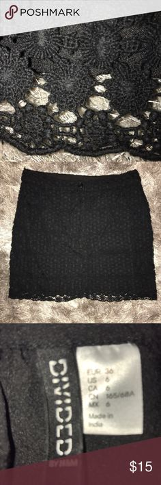 Divided by H&M black lacy crochet skirt SZ 6 A sweet crocheted lace skirt, can be worn with just about anything. Sandals and a T-shirt weight shirt, or heels and a silk blouse. Sexy off the shoulder top, or simple summer tank. No matter what you put with it you're going to look good. Divided by H&M Skirts Mini