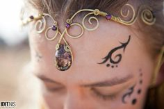 Magical fairy tiara made of brass and beautiful natural stones.The center of the tiara is embedded with a Rutilated Quartz that shines from a