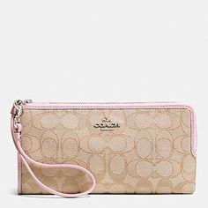 coach coin purse outlet nd3c  COACH ZIPPY WALLET IN SIGNATURE FABRIC