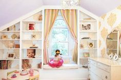 DIY built-in bookshelves, window seat, and crown molding were added to this child's bedroom with awkward wall angles