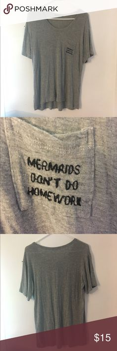 """Gray Brandy Melville Shirt Gray Brandy Melville Shirt, One Size, great condition, says """"Mermaids Don't Do Homework"""" on the pocket. Bundle and save! Brandy Melville Tops Tees - Short Sleeve"""