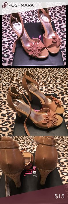 Tan open toe heels with flowers on the toe Patten leather and cork sandal with cute flowers on the toes and ankle straps. These shoes are used but in great condition. The heels are not scuffed and there is minimal sign of wear on the bottom only. This is a great work, church, date or any day shoe. 2 1/2 in heel. Shoes Sandals