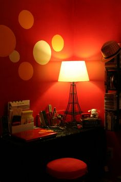 Paint circles on red wall