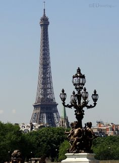This elegant lamp post is part of the Pont Alexandre III providing a view to the Eiffel Tower in the background.  Daily updates at www.eutouring.com/images_pont_alexandre_iii.html